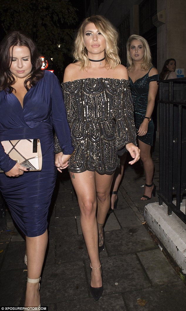What a night! The party girl gripped a pal's hand as she made her way out