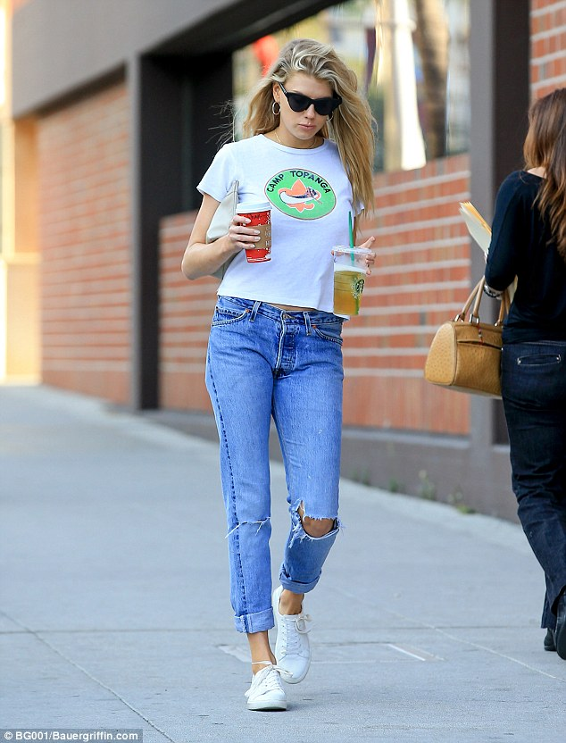Dropping a hint: Her T-shirt's hem was cut high enough to bare only a faint trace of midriff