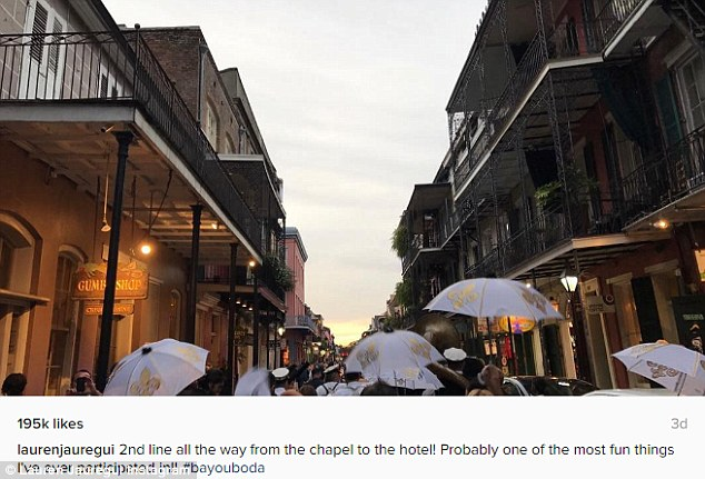 '2nd line all the way from the chapel to the hotel!': She also posted a photo of revellers carrying white umbrellas splashed with gold fleurs-de-lis in what looked like a wedding procession