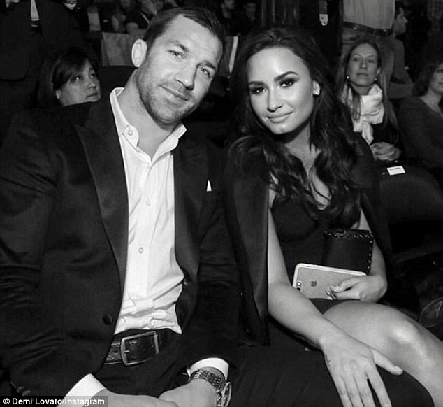 It's a match: Lovato looked content as she stepped out with her new beau, UFC fighter Luke Rockhold, at Madison Square Garden on Saturday. Both subsequently posted the shot on their respective Instagram pages with the caption, 'About Last Night'