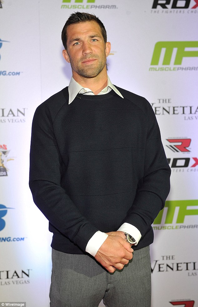 Cleans up well: The one-time UFC Middleweight champ, seen here last year at an event in Las Vegas, looks like a movie star himself in his fashionable threads