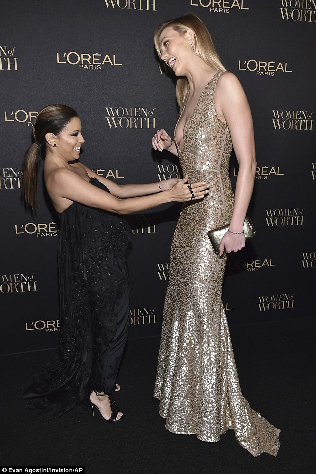 You're so tall!Karlie, who stands at 6ft2in towered over fellow attendee Eva, who is a foot shorter at 5ft2in