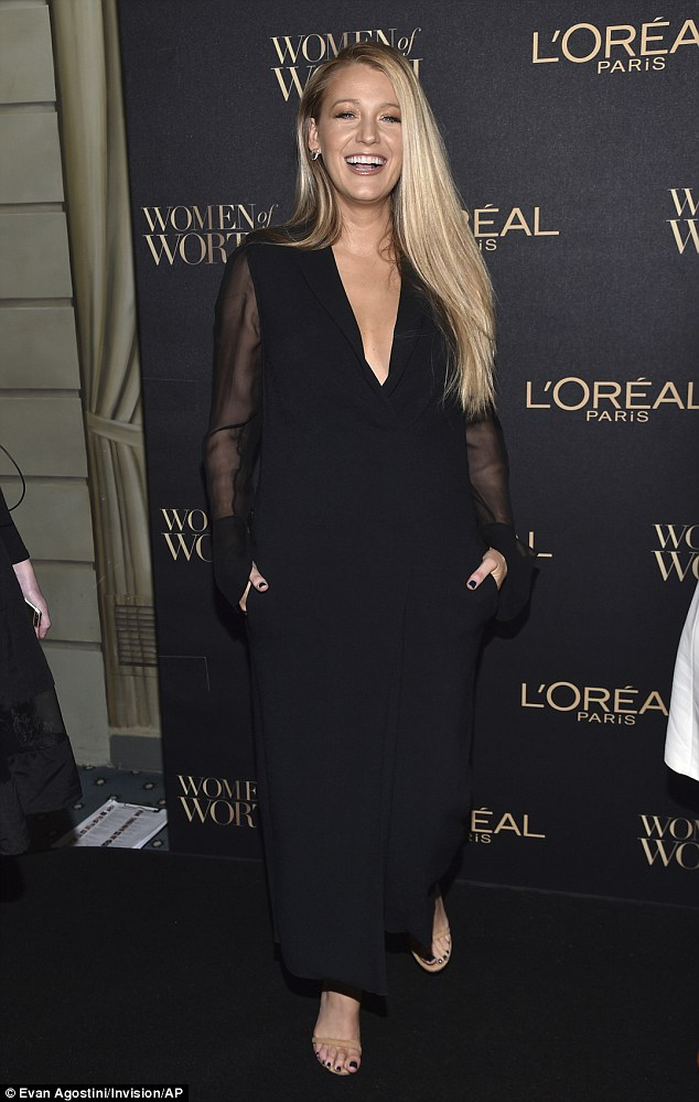 Laughing out loud!The gorgeous blonde, 29, wore a loose-fitting navy dress with sheer sleeves as she let her golden hair fall over her shoulders