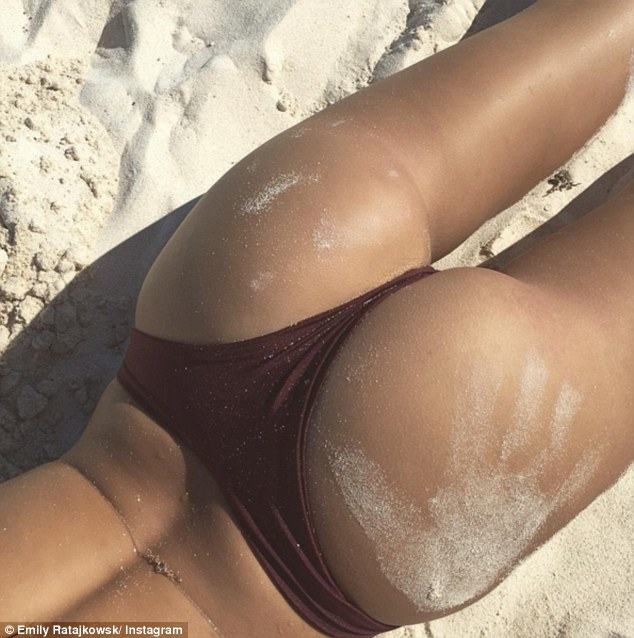 Sandy sights:The 25-year-old Gone Girl star wowed in her sexy shot which showed off every inch of her sensational physique as she went totally naked for the image which was snapped from the side to help protect her modesty