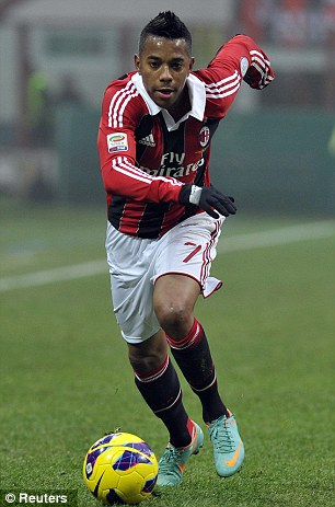 Surplus to requirements: Robinho (left) and Alexandre Pato will be sold for AC Milan to acquire a transfer kitty for Balotelli