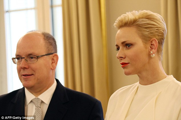 The Prince and Princess of Monaco stood side-by-side as they looked on while handing out gifts during the ceremony
