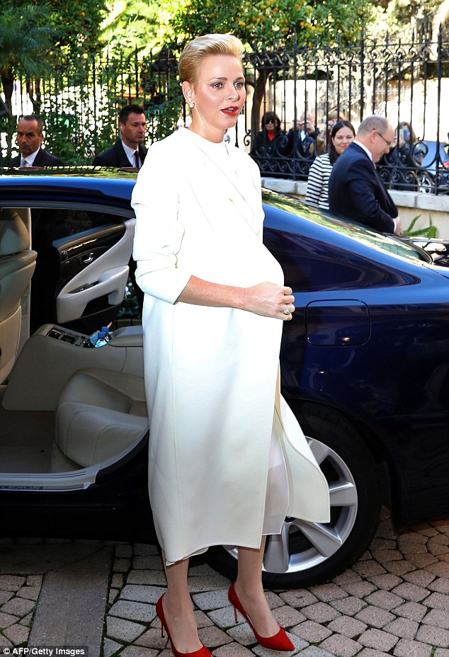 As Princess Charlene of Monaco arrived at the headquarters, she flashed a peek of her see-through slip