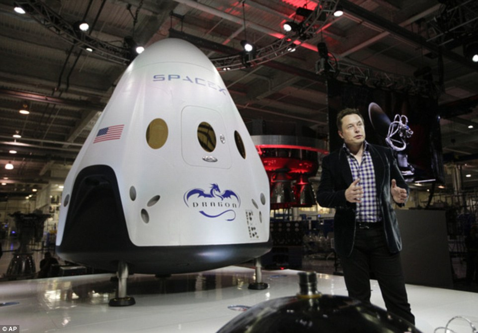 In this May 29, 2014 photo, Elon Musk, CEO and CTO of SpaceX, introduces the SpaceX Dragon V2 spaceship - now referred to as Crew Dragon - at the SpaceX headquarters in Hawthorne, California. Nasa also selected Boeing's CST-100 as another private vehicle they will use to take astronauts to space