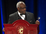 Supreme Court Justice Clarence Thomas comments on a spoon and fork he found on the podium while he addresses the Federalist Society's National Lawyers Convention dinner at National Harbor, in Oxon Hill, MD, Thursday, Nov. 17, 2016. The convention is dedicated to the legacy of Supreme Court Associate Justice Antonin Scalia who died Feb 13, 2016. (AP Photo/Cliff Owen)