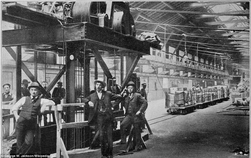 Opening of Chicago subway for freight traffic: On July 7, 1905, an 11-car train was dispatched from the Erie freight house. These five cars were delivered to the Milwaukee freight house and the elevator in the foreground goes down to the tunnel