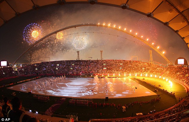 Warming up: Fans are given a treat as fireworks mark the start of the Asian Cup at Khalifa Stadium in Doha