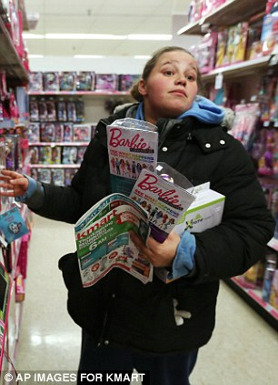 Barbie for Christmas: Stephanie Torres, of Chicago, stocks up on Barbie dolls during Kmart's Thanksgiving Day doorbuster sale at the Addison St. Store in Chicago