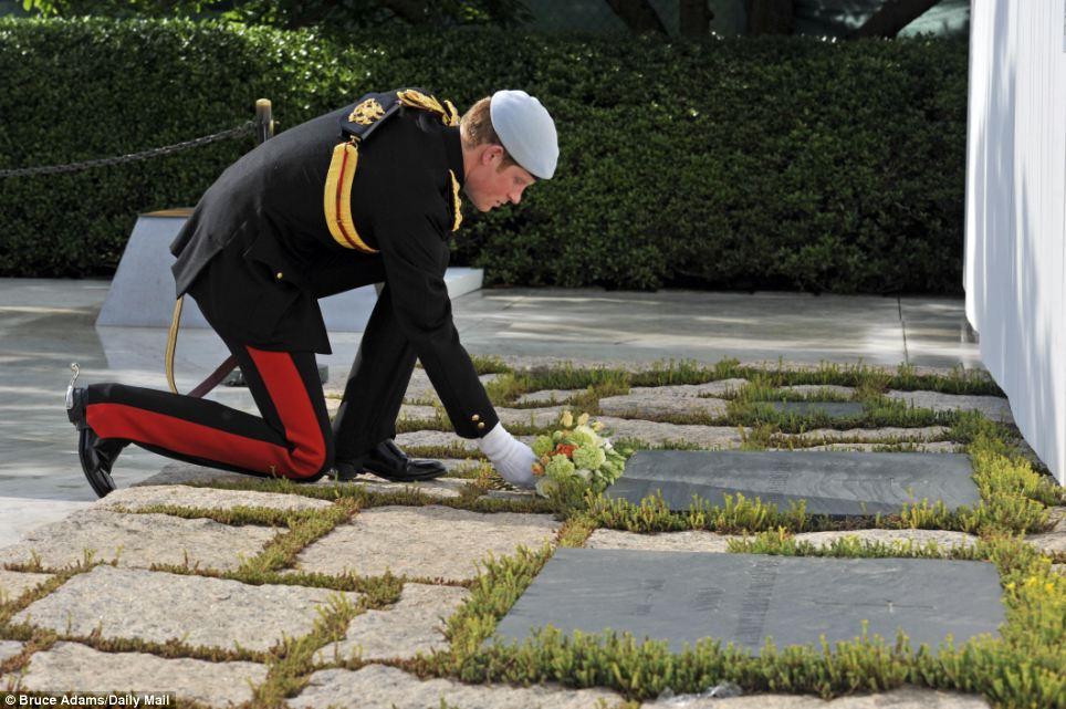 Historic: Harry lays a wreath at the memorial of President John F. Kennedy at Arlington National Cemetery. This November marks 50 years since his assassination