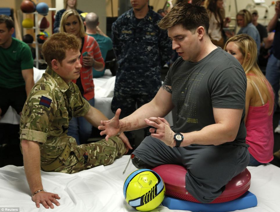 Inspirational: Staff Sgt. Payne, who lost both of his legs while serving in Kandahar, told Harry of his injuries: 'It's all mind over matter'