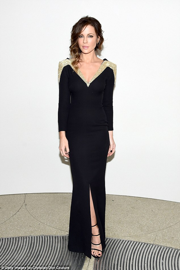 Gold shoulder: Kate Beckinsale looked mesmerizing in svelte black gown as she attended the Guggenheim International Gala on Thursday night.