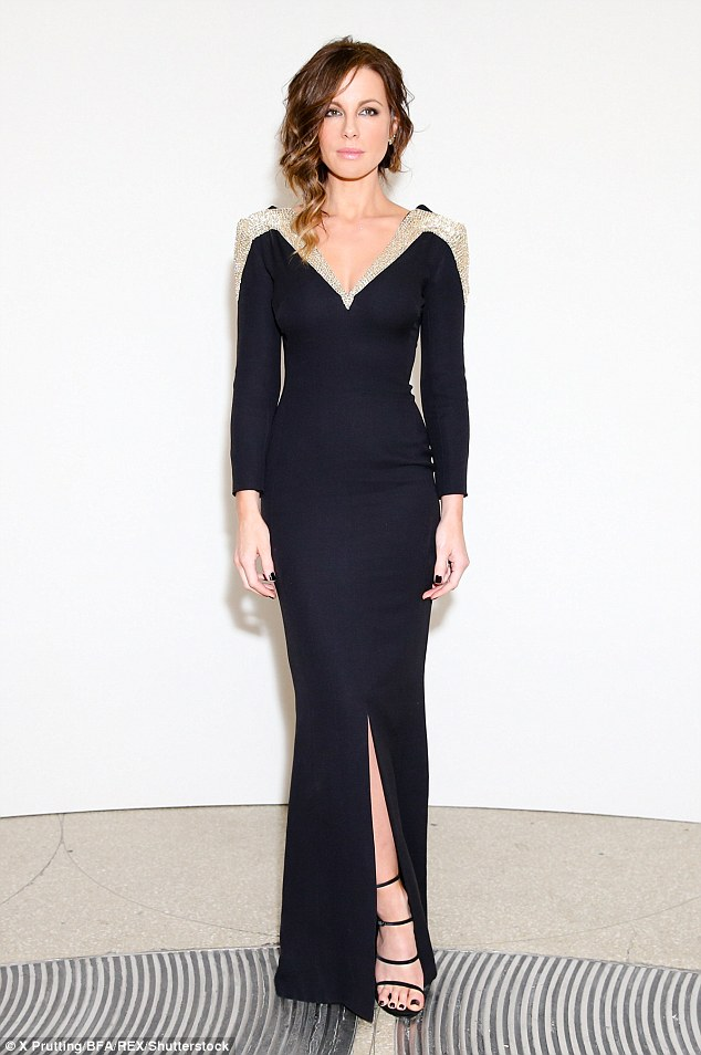 Wow: The 43-year-old was the perfect showcase for the floor-length piece, which featured a glittering gold trim running from her shoulders along the v-shaped neckline