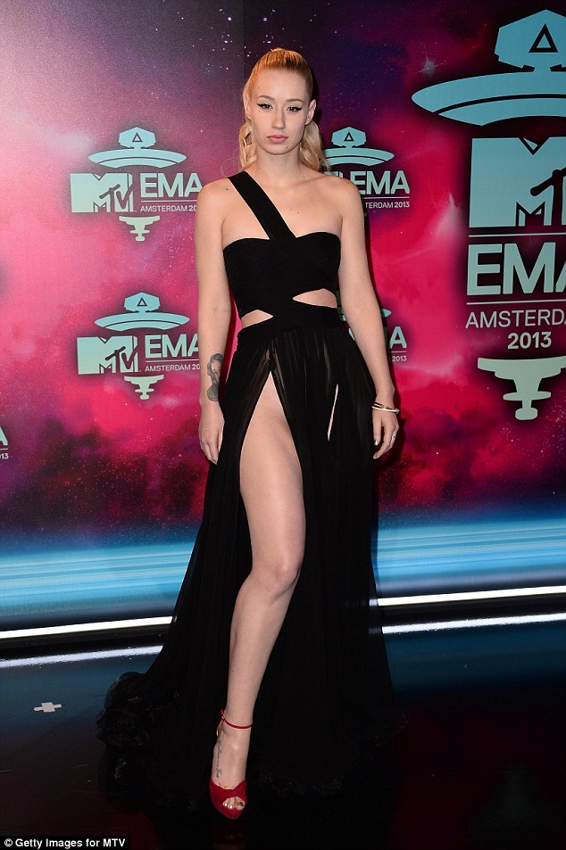Not shy: Iggy is equally confident about revealing other parts of her body (pictured on the EMA red carpet in 2013)