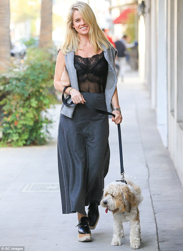 Poochy phew: Alice Eve was hot to trot as she went for a stroll with her dog in LA Wednesday