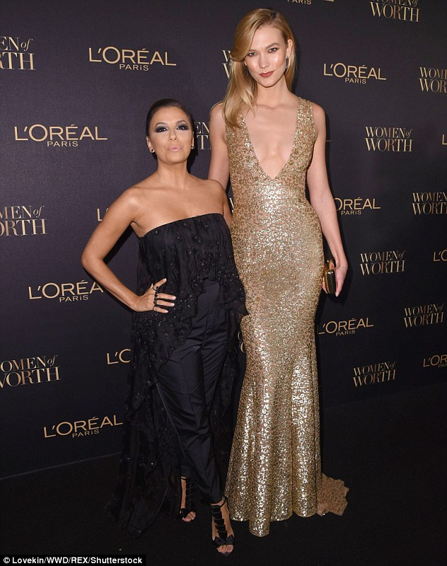 Fine being the mini-me!Eva, 41, seemed to be marveling over the height difference
