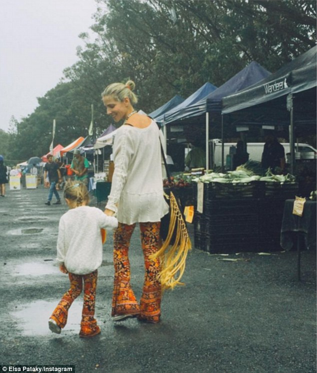 'Fun at the Byron farmers market!' Elsa Pataky, 40, shared a photo of herself and daughter India Rose, four, exploring the fruit and vegetable stands at the Byron Bay farmers' market, both clad in orange flared trousers by designer Arnhem