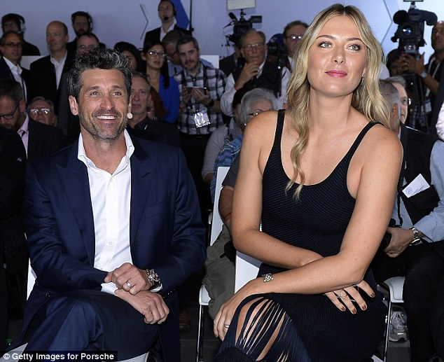 Sartorial elegance: The former Grey's Anatomy star was dapper in a dark blue suit and a white shirt, while Maria wore a low-cut black dress with a fringe hem