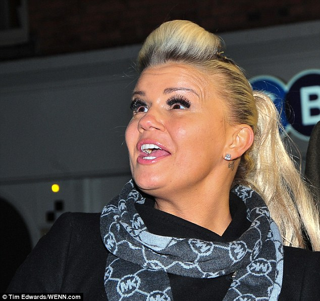 Hair-raising:The former pop star caught plenty of attention from her fans as she  kicked off the festivities in the town with a smile - and a somewhat retro hairstyle to boot