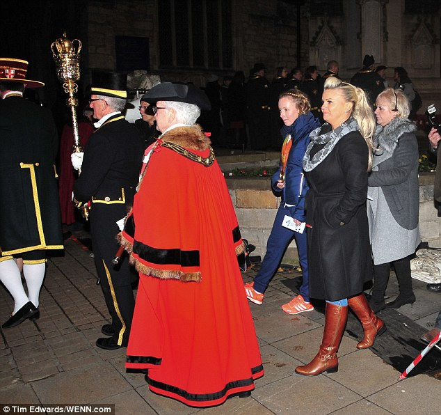 Stylish: Feeling the chill more up north, the blonde ensured she was well protected from the cold in a chunky but stylish black coat, which cinched in at her waist