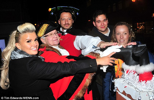 Getting into the (Christmas) spirit:Kerry happily signed autographs and took photos with fans and the mayoral party