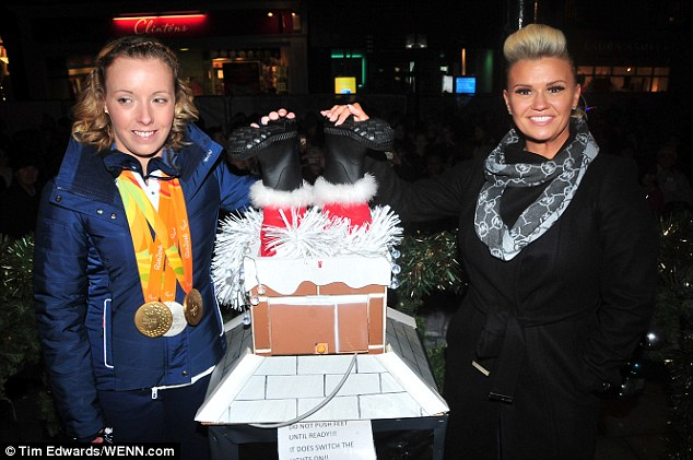 Ready, set... She prepared to light up the town with fellow special guest Sophie Wells (L) - a British para-equestrian