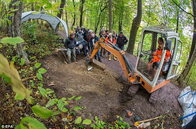 End of the mystery? A digger clears the earth during the exhumation of the grave of so-called 'Dark Countess' in Hildburghausen, Germany