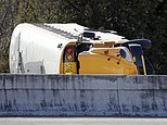 Officials work at the scene of a school bus crash on an interstate highway off-ramp Friday, Nov. 18, 2016, in Nashville, Tenn. Authorities say multiple students were injured, all of whom are expected to survive. (AP Photo/Mark Humphrey)
