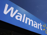 FILE - In this May 16, 2011 file photo, the Wal-Mart logo is displayed in Springfield, Ill. Wal-Mart Stores Inc. said Monday, Nov. 21, 2016, that it¿s kicking off its so-called ¿Cyber Monday¿ deals at 12:01 a.m. EST Friday for the first time ever as it aims to grab customers ahead of its competitors. (AP Photo/Seth Perlman, File)