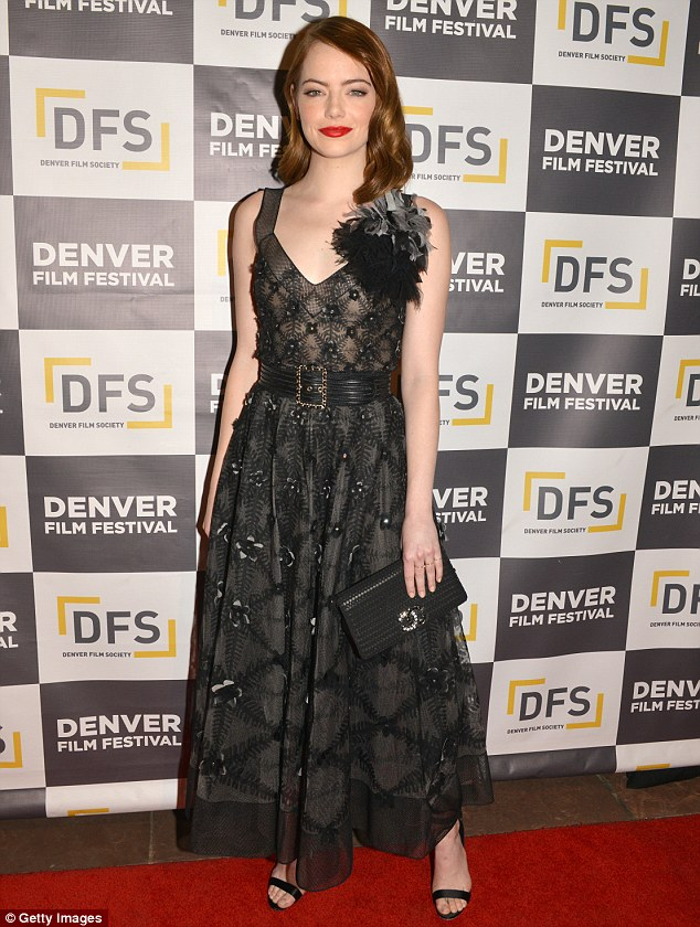Stylish display: Emma Stone looked typically glamorous in a sweeping Chanel dress during an official presentation of new film La La Land at the 39th annual Denver Film Festival on Wednesday evening