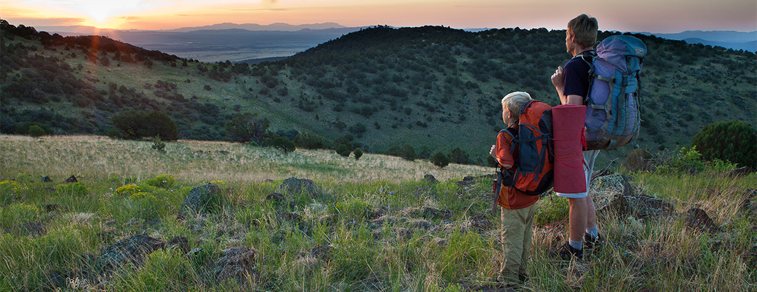 Father and son watch the sunset from the Continental Divide Wilderness Study Area. Photo by Bob Wick, BLM.