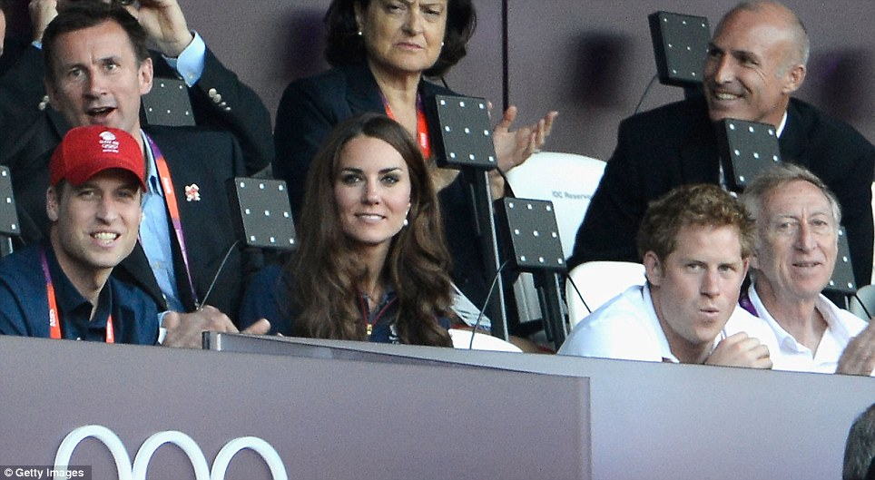 By Royal appointment: The Duke and Duchess of Cambridge and Prince Harry, sitting in front of the Culture Secretary Jeremy Hunt, were among the 80,000 spectators inside the Olympic Stadium