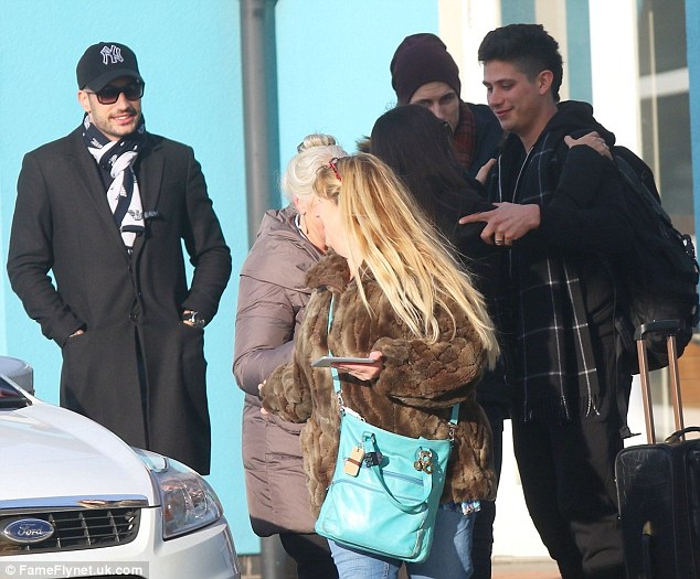 Relaxed: Giovanni Pernice looked on smiling at the two having a moment