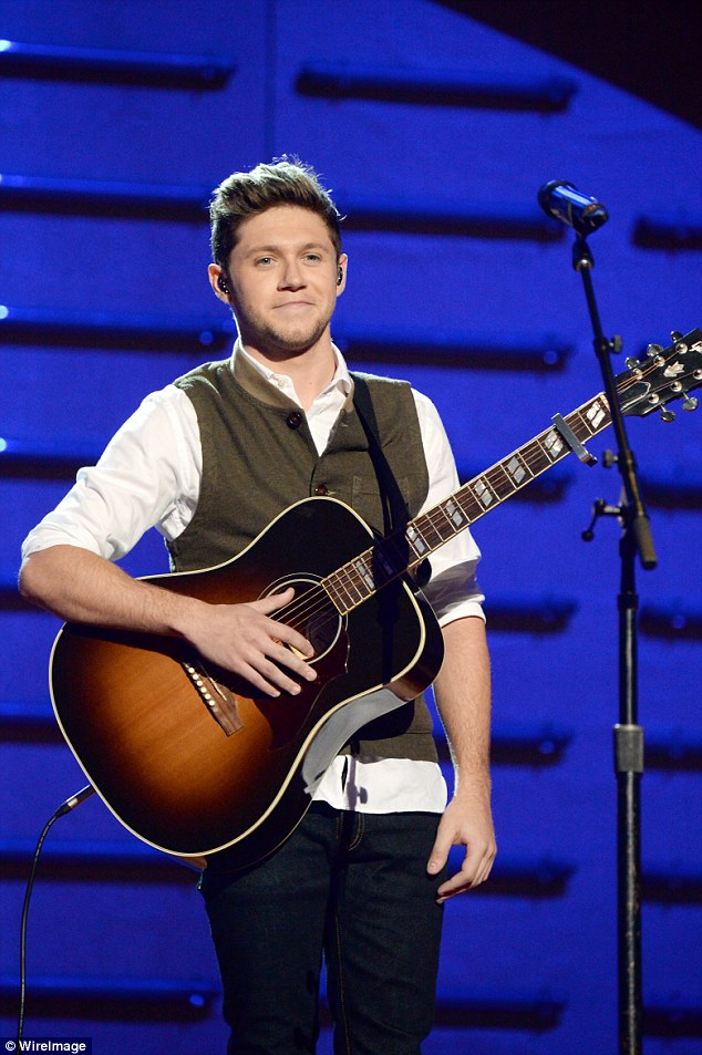 Belting it out: Former One Direction star Niall belted out his debut solo hit This Town at the event