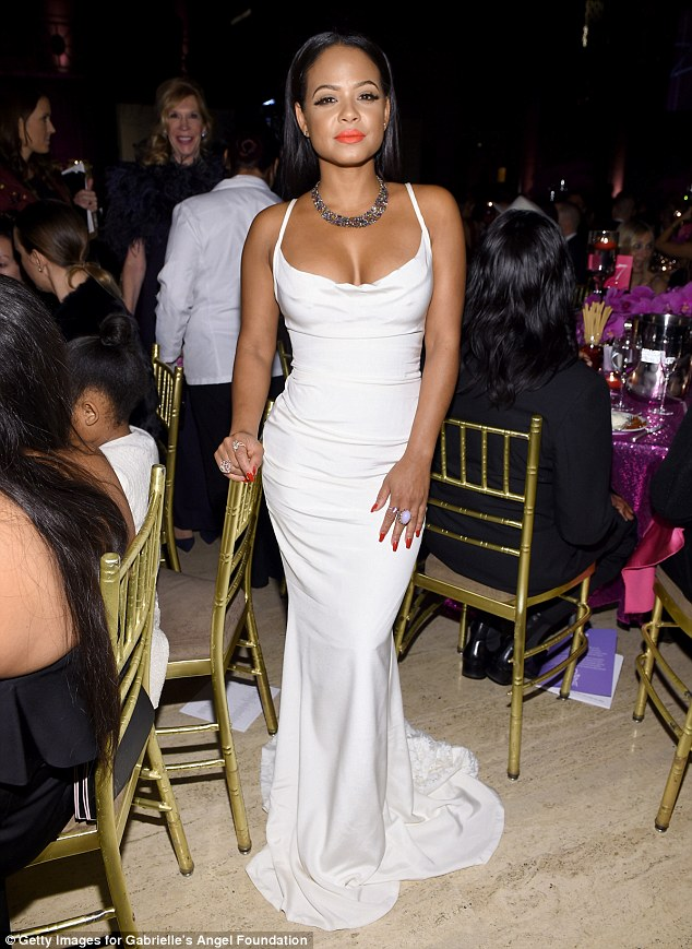 Eye-popping!The Bring It On actress flaunted her ample bosom in the skintight plunging gown with flowing train