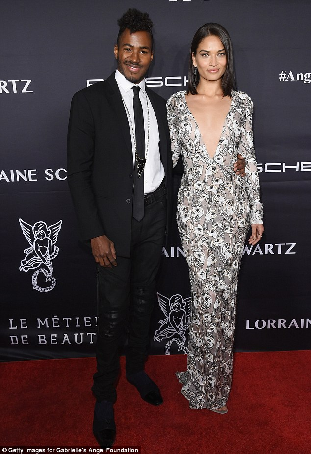 Taking the plunge! Victoria's Secret model Shanina Shaik, 25, stunned in a sheer floral gown as she posed with fiancéDJ Ruckus, 33
