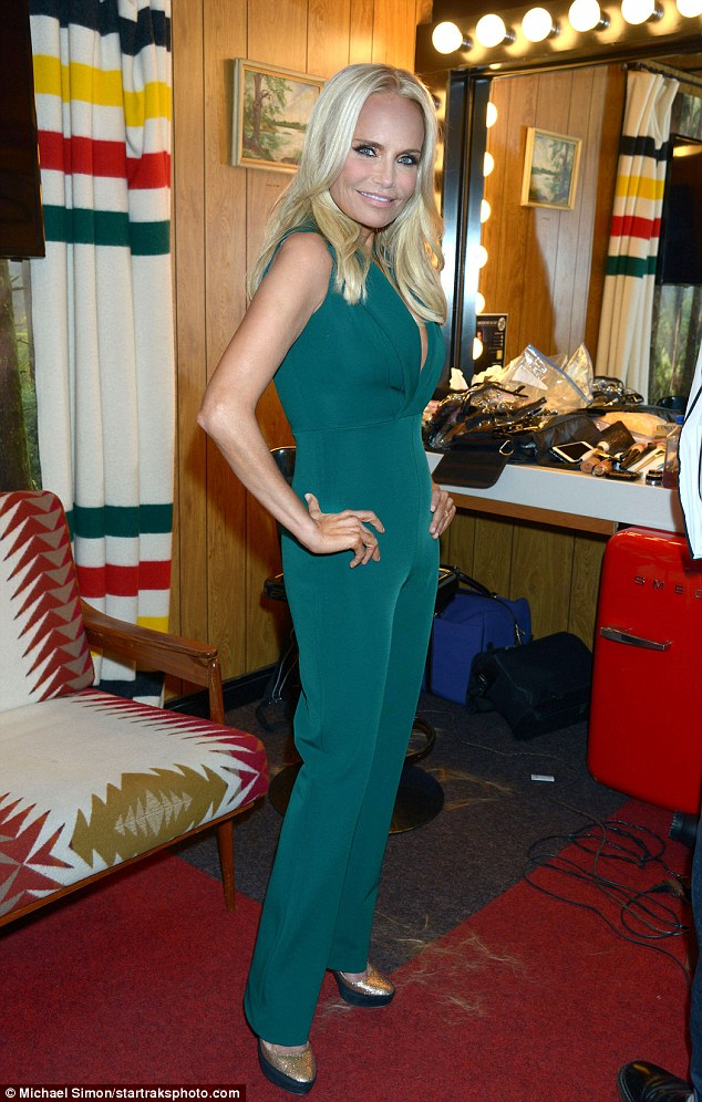 Skinny mini: The pint-size actress looked slender in the striking number
