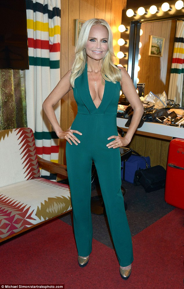All eyes on her: Kristin Chenoweth, 48, wore a daring green bodysuit for her appearance on The Tonight Show with Jimmy Fallon on Monday