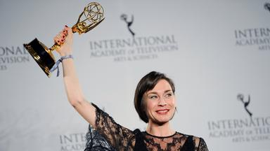 christiane paul cries as she holds the international emmy award in the best performance by an actress category of the internatio