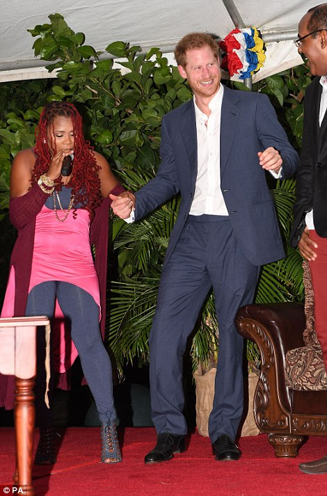 Prince Harry dancing on stage