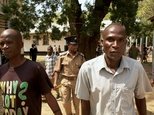 """Eric Aniva (right), known as a """"hyena"""" arrives to the Magistrate Court on August 15, 2016 in Nsanje ©Eldson Chagara (AFP/File)"""