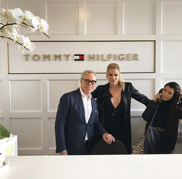 'Somebody's gotta answer the phone' Khloe (center) and Kourtney (R) visited Tommy Hilfiger's NYC office with mother Kris Jenner earlier in the day