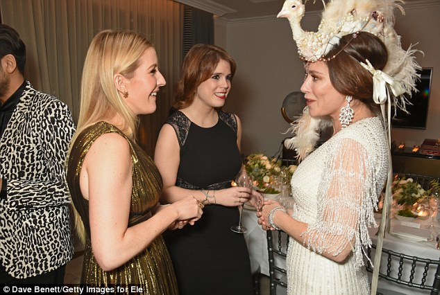 Birds of a feather: Anna was hard to miss in her feather embellished headpiece