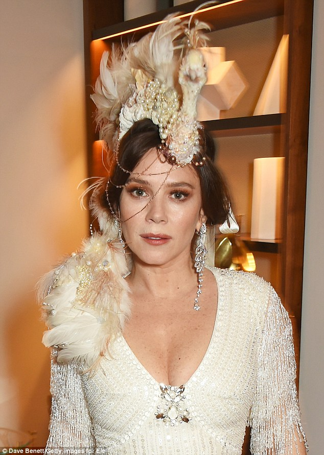 Amazing: The actress donned a beaded gown with a bejeweled neckline and tasseled sleeves, perfectly coordinating with her regal bird headpiece