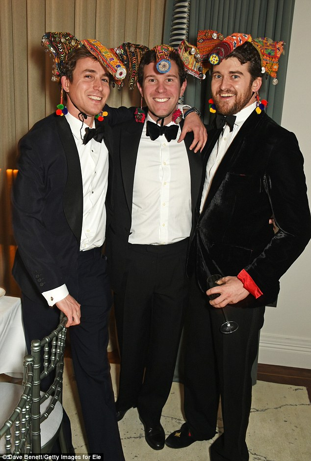 Three's no crowd: Jake Thomson, Jack Brooksbank and Hickman Bacon all sported the same vibrant headpieces