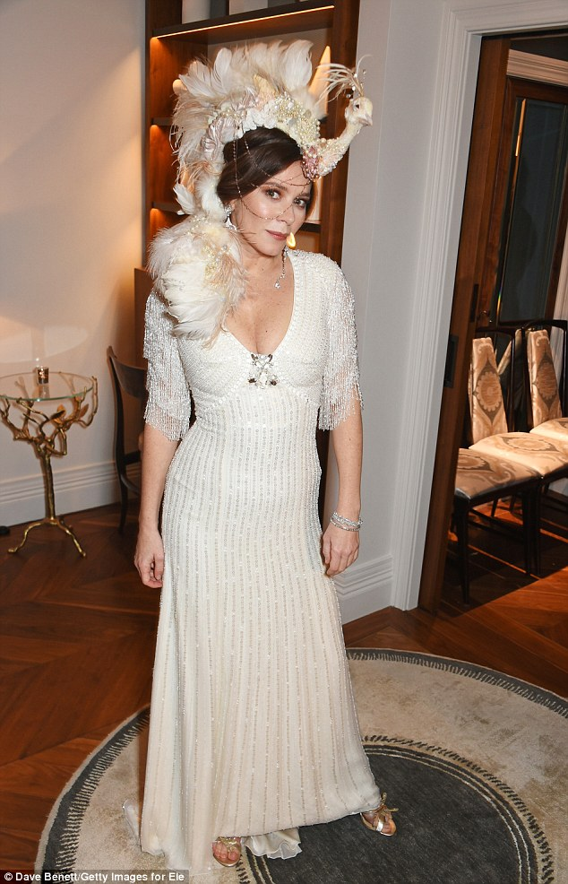 Bridal couture: Anna Friel looked seriously striking in a beaded white gown and peacock headdress