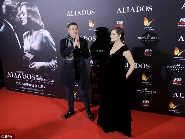 A bumpy ride:The 41-year-old French actress kept her bump under wraps in a plunging black gown with a bow-detail at the chest while Brad looked dashing in a suit with a white shirt and thick scarf